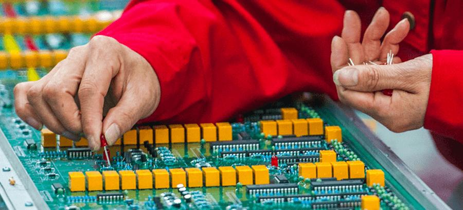 Man selecting electronics board